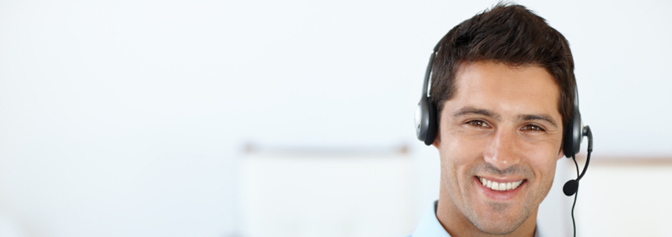 Cropped shot of a young man wearing a headset in his office